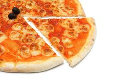 Pizza mozzarella with a slice removed Royalty Free Stock Photo