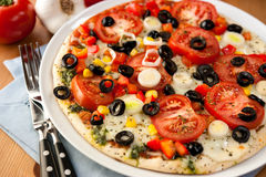 Pizza with mozzarella and vegetables Royalty Free Stock Photo
