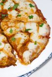Pizza with mozzarella on a white plate, vertical closeup Royalty Free Stock Image