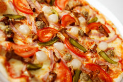 Pizza with mushrooms. Tomatoes, cucumbers. Macrograph with shallow depth of field Royalty Free Stock Photos