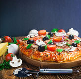 Pizza with mushrooms and cheese served stock photo