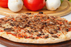 Pizza with mushrooms and cheese Royalty Free Stock Photo