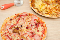 Pizza with mushrooms and ham Stock Images