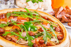 Pizza with mushrooms, ham and vegetable Stock Photo