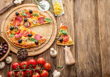 Pizza with mushrooms, salami and tomatoes. Royalty Free Stock Photos