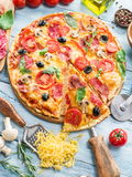 Pizza with mushrooms, salami and tomatoes. royalty free stock photography