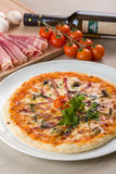 Pizza with mushrooms. Served with ingredients Stock Images