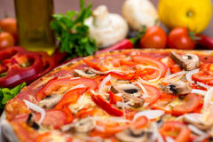 Pizza with mushrooms on table royalty free stock images