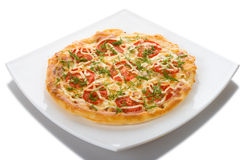 Pizza na placa Fotos de Stock Royalty Free