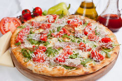 Pizza Napoli. With cherry and cheese royalty free stock images
