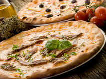Pizza napoli and capricciosa-. Pizza napoli and capricciosa with ingredients royalty free stock image