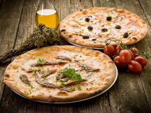 Pizza napoli and capricciosa. With ingredients royalty free stock photo
