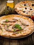 Pizza napoli and capricciosa-. Pizza napoli and capricciosa with ingredients royalty free stock photography