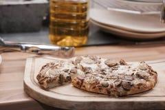 Pizza nella cucina Immagine Stock