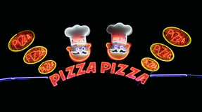 Pizza At Night. Neon Light Advertising Royalty Free Stock Photos