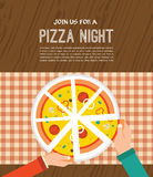 Pizza night invitation. People having dinner. People having  dinner together and sharing a huge pizza , hands top view Royalty Free Stock Photography
