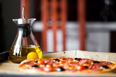 Pizza with olive oil royalty free stock images