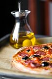 Pizza with olive oil Royalty Free Stock Photography