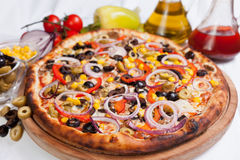 Pizza with Olive and Onion. And oil royalty free stock photography