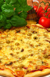 Pizza with olives. Tomatoes and mozzarella cheese stock photography