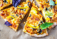 Pizza with olives, peppers and basil Stock Images