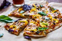 Pizza with olives, peppers and basil Royalty Free Stock Photos