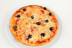 A pizza with olives and salami stock photography