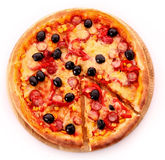 Pizza with olives on wooden plate isolated Stock Images