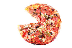 Pizza with one slice removed Isolated on white.  royalty free stock photography