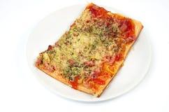 Pizza op een plaat Stock Afbeelding