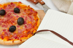 Pizza with notebook Stock Photos