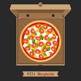 Pizza in the opened cardboard box. Royalty Free Stock Images