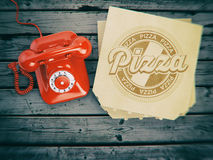 Pizza ordering and delivery concept. Vintage telephone and pizza. Boxes on wooden background. 3d illustration Royalty Free Stock Images