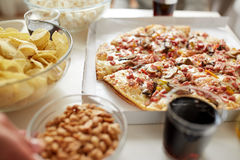 Pizza and other fast food snacks on table Royalty Free Stock Image