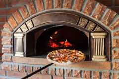 Pizza on oven. Is Italian food with fire royalty free stock photos