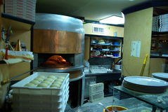 Pizza oven. Pizzeria with pizza oven and the buns Royalty Free Stock Images
