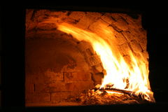 Pizza oven. Burning fire in a traditional pizza oven Stock Images