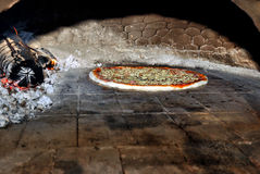 Pizza in oven Royalty Free Stock Photos