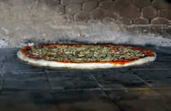 Pizza in oven Royalty Free Stock Image