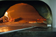 Pizza oven burning Stock Photography