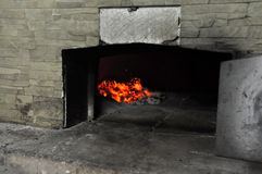 Pizza oven fire stock photos