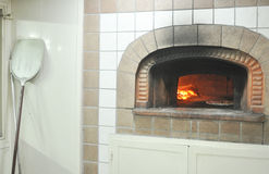 Pizza oven. A firewood pizza oven and a shovel Royalty Free Stock Photos