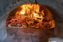 Pizza oven with flame, fire and pizzas Royalty Free Stock Photo