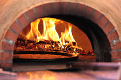 Pizza oven with flame in restaurant Stock Image