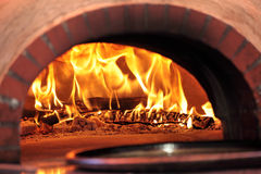Pizza oven with flame in restaurant Stock Photo