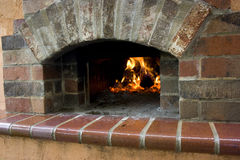Pizza Oven Hearth. Brick front with view of fire burning inside royalty free stock photography
