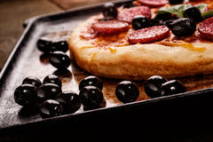 Pizza on oven rack Royalty Free Stock Photos