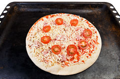 Pizza on oven tray Royalty Free Stock Photos