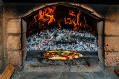 Pizza oven, vegetarian pizza. Ready to go in Stock Image
