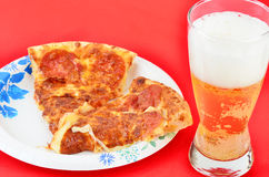 Pizza on Paper Plate Stock Image